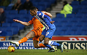 Brighton striker, Rajiv van La Parra (27) and Ipswich Town defender Jonas Knudsen (3) during the Sky Bet Championship match between Brighton and Hove Albion and Ipswich Town at the American Express Community Stadium, Brighton and Hove, England on 29 December 2015.