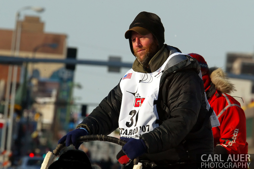 3/3/2007:  Anchorage Alaska -  Veteran Bill Pinkham of Glenwood Springs, CO heads out during the Ceremonial Start of the 35th Iditarod Sled Dog Race