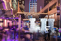 Minneapolis, MN - Feb 2, 2018: Super Bowl LII ice sculpture on Nicollet Mall in Minneapolis. Crowds surround the sculpture and take selfies or are photographed by volunteers. Super Bowl LII will be held in Minneapolis at US Bank Stadium on Feb 4, 2018.