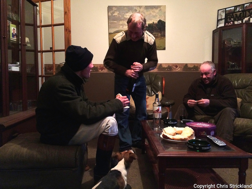 Hunstman Johnny Richardson is fed and watered by local shepherds after a days hunting.