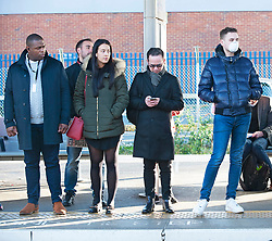 ©Licensed to London News Pictures 13/03/2020<br /> Pettswood, UK. Commuters stare at a man wearing a face mask.  London commuters at Pettswood train station this morning in Pettswood, Kent are keeping their distance from each other by standing a meter apart as the Coronavirus threat continues in the UK. Commuter numbers are down as many work from home.  Photo credit: Grant Falvey/LNP