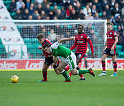 4th November 2017, Easter Road, Edinburgh, Scotland; Scottish Premiership football, Hibernian versus Dundee; Dundee's Lewis Spence battles for the ball with Hibernian's John McGinn