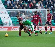 4th November 2017, Easter Road, Edinburgh, Scotland; Scottish Premiership football, Hibernian versus Dundee; Dundee's Lewis Spence battles for the ball with Hibernian's John McGinn