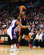 Jan. 24, 2012; Phoenix, AZ, USA; Toronto Raptors forward James Johnson (2) puts up a shot against the Phoenix Suns forward Markieff Morris (11) during the first half at the US Airways Center. Mandatory Credit: Jennifer Stewart-US PRESSWIRE.
