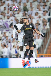 Real Madrid's Vinicius Junior and Manchester City's Riyad Mahrez during the UEFA Champions League round of 16 first leg match Real Madrid v Manchester City at Santiago Bernabeu stadium on February 26, 2020 in Madrid, Sdpain. Real was defeated 1-2. Photo by David Jar/AlterPhotos/ABACAPRESS.COM