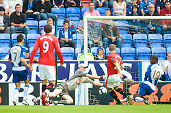 WIGAN, ENGLAND - Saturday, August 22, 2009: Manchester United's Darren Fletcher misses a sitter against Wigan Athletic's goalkeeper Chris Kirkland during the Premiership match at the DW Stadium. (Photo by David Rawcliffe/Propaganda)
