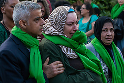 London, UK. 14th June, 2018. Mayor of London Sadiq Khan consoles a woman during the Grenfell Silent March through West Kensington on the first anniversary of the Grenfell Tower fire. 72 people died in the Grenfell Tower fire and over 70 were injured.