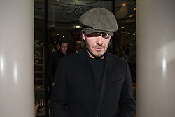 © Licensed to London News Pictures . 10/12/2013 . Manchester , UK . DAVID BECKHAM exits San Carlo restaurant in central Manchester this evening (10th December 2013) . Photo credit : Joel Goodman/LNP