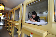 Welcome to China's bleak capsule hotels where young travellers pay £7 a night to sleep in pods only just big enough to lie down<br /> <br /> China's minute capsule hotels are gleaning popularity with young travellers due to their very affordable price tags.<br /> The Space Capsule hotel, in Taiyuan, in the Shanxi province, is one of many to open up in China, after the trend for sleep pods began in Japan, decades ago.<br /> Each of the pokey rooms measure a mere 4.3 feet by 6.6 feet, but costs just under £7 ($10.59) per night to stay in, making them a tempting prospect for budget travellers and young people. <br /> The 5,200 square-foot building consists of 86 fibreglass capsules in nine rooms, each named after star signs to reflect the space theme.<br /> Along with a simple bed, the rooms contain a mirror, television, smoke detector, coat hook and fold-down computer desk.<br /> Each is also equipped with is a plug socket, smoke detector and a fan.There's a wireless network for those who wish to stay connected, and even a selection of soundproofed capsules reserved for people who snore.<br /> According to Chinese newspaper, Xinhua, the hotel manager Xu Meijang was inspired to open the unusual business by the popularity of sleep pod hotels in Japan and by the number of generally young travellers requiring an affordable night's stay in the area.<br /> ©Exclusivepix Media