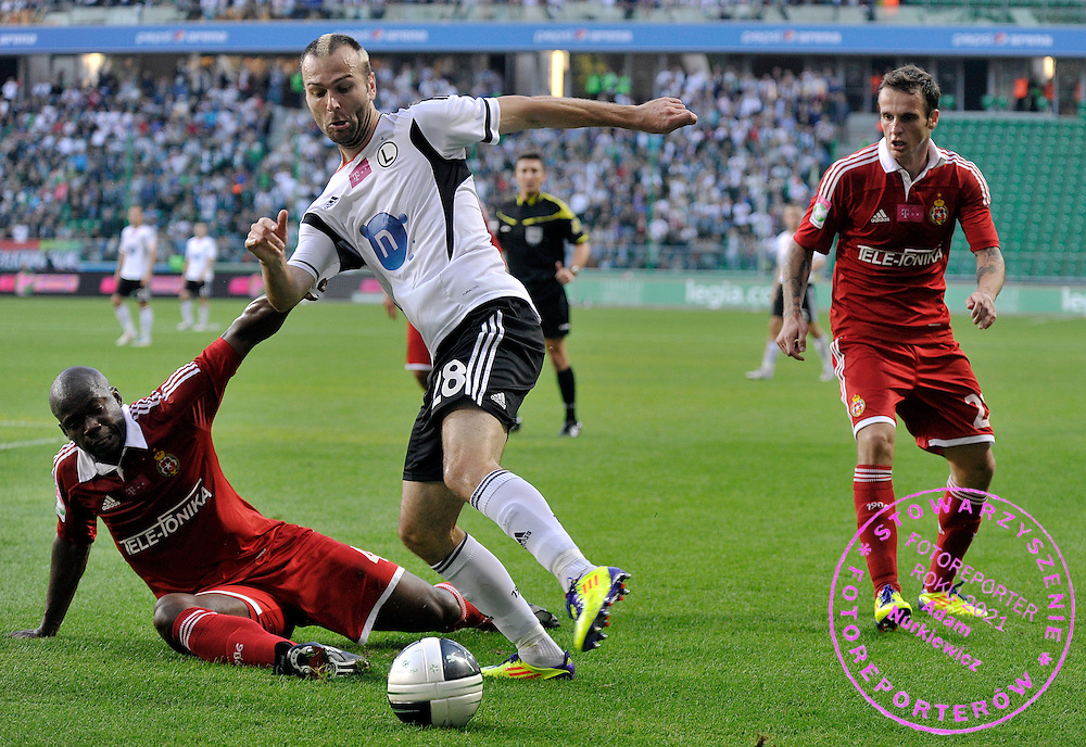 (C) Legia's Danijel Ljuboja fights for the ball with (L) Wisla's Osman Chavez during T-Mobile Extraleague soccer match between Legia Warsaw and Wisla Cracow in Warsaw, Poland...Poland, Warsaw, October 02, 2011..Picture also available in RAW (NEF) or TIFF format on special request...For editorial use only. Any commercial or promotional use requires permission...Photo by Adam Nurkiewicz / Mediasport