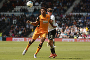 Derby County midfielder Craig Bryson and Hull City striker Chuba Akpom battle for the ball during the Sky Bet Championship play-off first leg match between Derby County and Hull City at the iPro Stadium, Derby, England on 14 May 2016. Photo by Alan Franklin.