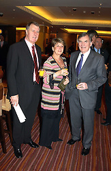 Left to right, SIR GEOFF & LADY HURST and footballer DEREK UFTON a director of Charlton Athletic FC at a party to celebrate the opening of The Sportsman - a casino, bar and restaurant in Old Quebec Street, London W1 on 12th January 2005.  Proceeds from the casino were donated to the charity Sparks the sports charity.<br /><br />NON EXCLUSIVE - WORLD RIGHTS