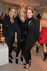 Left to right, LIZ McNAMARA, ARABELLA DUNN and JULIA KONIG at a party at Herve Leger, Lowndes Street, London on 12th November 2014 to view the latest collection.