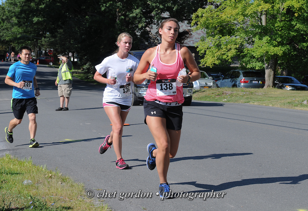 Runners make their along Windermere Avenue during the Greenwood Lake Inaugural 5K Run in Greenwood Lake, NY on Saturday, August 9, 2014.  © Chet Gordon/THE IMAGE WORKS