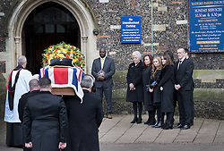 © Licensed to London News Pictures. 01/02/2017. Watford, UK. The family (R) of former England football team manager Graham Taylor watch as his flag draped coffin arrives at St Mary's Church in Watford, Hertfordshire. The former England, Watford and Aston Villa manager,  who later went on to be chairman of Watford Football Club, died at the age of 72 from a suspected heart attack. Photo credit: Peter Macdiarmid/LNP