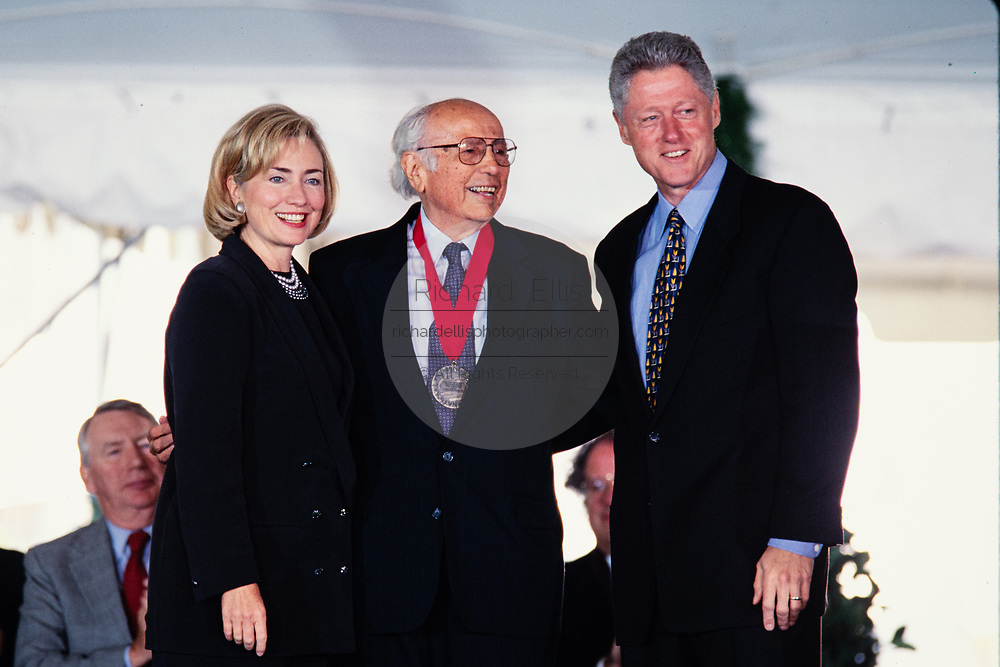 Professor and author Luis Leal is presented the National Humanities Medal by President Bill Clinton and First Lady Hillary Clinton during a ceremony on the South Lawn of the White House September 29, 1997 in Washington, DC.