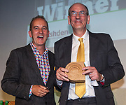 Kevin McCloud, author, broadcaster and designer presenting  Peter Nixon of the National Trust with an Ashden award. The 2012 Ashden Awards for sustainable energy ceremony at the Royal Geographical Society. London.