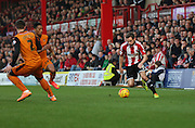 Douglas taking on the Wolves defence during the Sky Bet Championship match between Brentford and Wolverhampton Wanderers at Griffin Park, London, England on 29 November 2014.