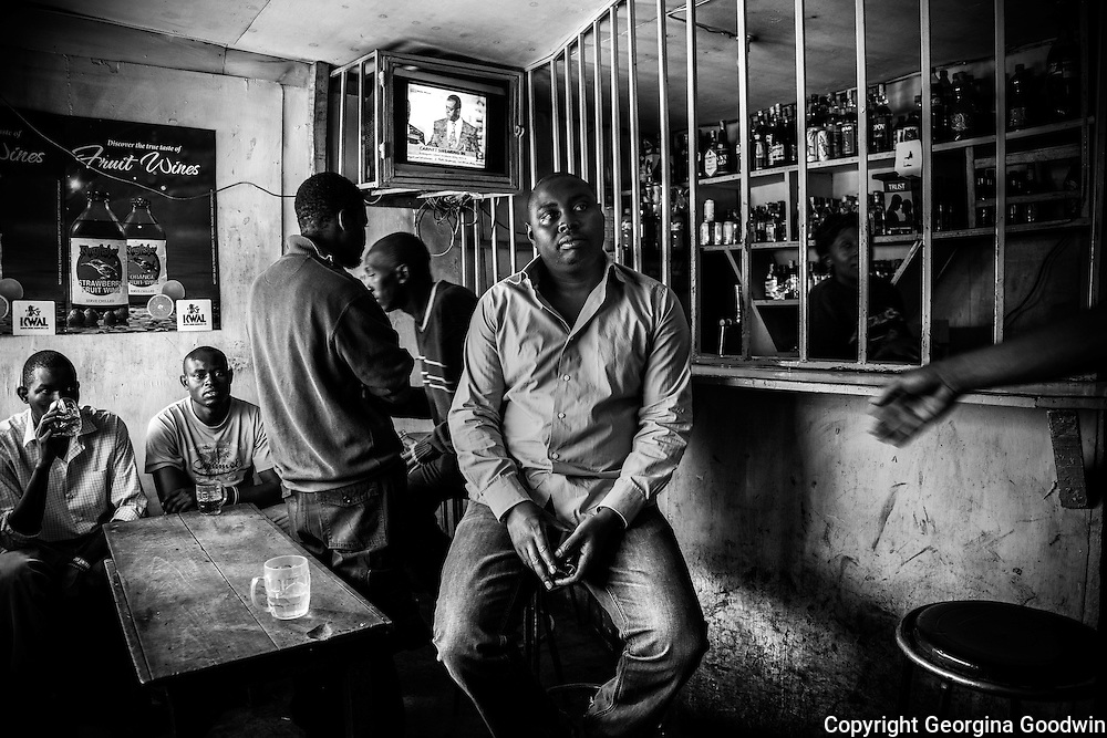 Mark Mutungi, owner of pubs 'Mark1' and 'Mark2' on Mugumoini's main road Kitengela Street. Pubs and bars such as these provide places for the community's men without work or prospects to find solace in alcohol. The two pubs are serviced by women and are often the breeding grounds from where rape and violence take place.<br /> This image is from a series focusing on and around the rape and the women victims that occur every half a day in Mugumoini Village in Nairobi's Southlands, a slum home to 20,000 people in abject poverty with little or no income, with the aim of creating exposure and empowerment for change. &copy;GGoodwin