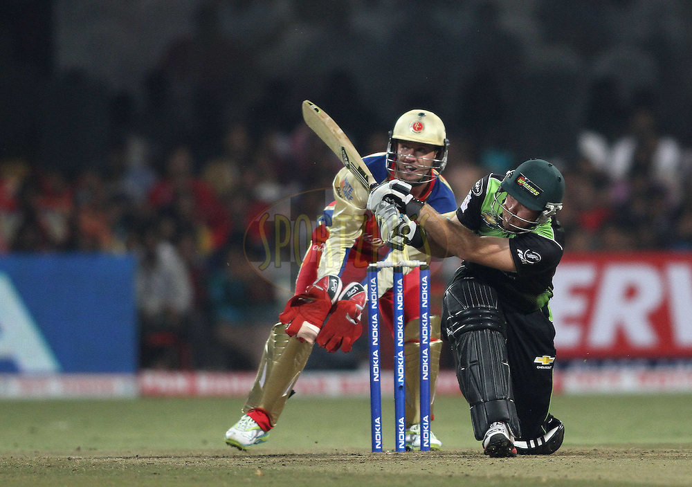 Colin Ingram of the Warriors hits over the top to be caught during match 1 of the NOKIA Champions League T20 ( CLT20 )between the Royal Challengers Bangalore and the Warriors held at the  M.Chinnaswamy Stadium in Bangalore , Karnataka, India on the 23rd September 2011..Photo by Shaun Roy/BCCI/SPORTZPICS