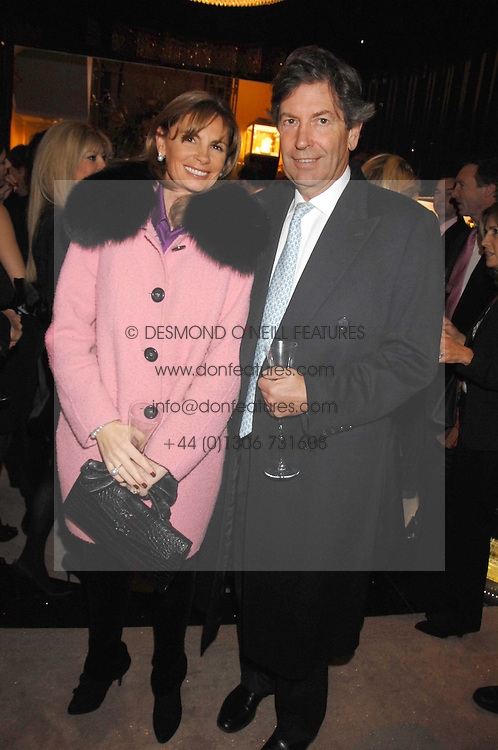 FIONA FEELEY and MR MICHAEL WIGAN at a Christmas party hosted by The Business and Alisa Moussaieff held at the Moussaieff showrooms, 172 New Bond Street, London on 5th December 2007.<br />