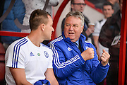 Chelsea Defender John Terry (26) and Chelsea Manger Guus Hiddink discuss tactics during the Barclays Premier League match between Bournemouth and Chelsea at the Goldsands Stadium, Bournemouth, England on 23 April 2016. Photo by Adam Rivers.