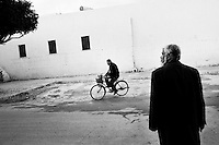 Tunis, Tunisia - 18 December, 2011: Said Ferjani, 57, senior member of the political and communication bureau of the Nahda (Renaissance) party, walks out of the Negra mosque where he started his activism when he was 16 years old, in Kairouan, Tunisia on 18 December, 2011. In the 24 October 2011 Tunisian Constituent Assembly election, the first elections since the Tunisian Revolution, the party won 40% of the vote, and 89 of the 217 assembly seats, far more than any other party. Said Ferjani started his activism in the Negra mosque of his hometown Kairouan when he was 16 years old, debating on politics, philosophy, economy and world events. In 1989 former dictator Zine El Abidine Ben Ali turned against Nahda (or Ennahda) and jailed 25,000 activists. Said Ferjani was jailed and tortured. He then flew Tunisia and moved to the UK. He came back to Tunisia after 22 years, after former dictator Ben Ali flew the country.<br /> <br /> Gianni Cipriano for The New York Time