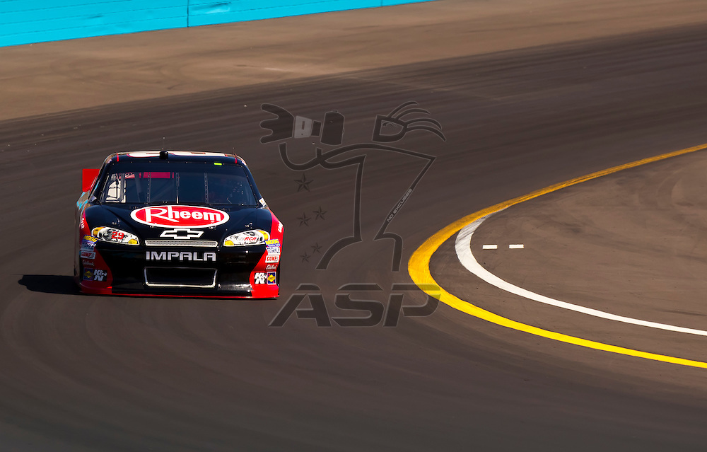 AVONDALE, AZ - MAR 03, 2012:  Kevin Harvick (29) brings his NASCAR Sprint Cup car through turn 4 during qualifying for the Subway Fresh Fit 500 race at the Phoenix International Raceway in Avondale, AZ.