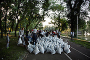 Volunteers along the Sava River in Belgrade, Serbia at Usce, the confluence of the Sava and Danube rivers prepare sandbags after potential flooding in the area.5/18/14.<br /> <br /> Matt Lutton / Boreal Collective<br /> <br /> Flooding in Serbia