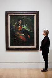 © Licensed to London News Pictures. 28/01/2013. London, UK. A Tate Britain employee views 'Untitled (Lovely Portrait)' (1942) an oil painting by Kurt Scwitters at the press view of an exhibition of the artists work taking place at the Tate Britain in London. The exhibition, 'Schwitters in Britain', is the first to to examine the work of the late German modernist artist's 'British period' (1940-1948), and runs from 30th of January 2013 to the 12th of May 2013. Photo credit: Matt Cetti-Roberts/LNP