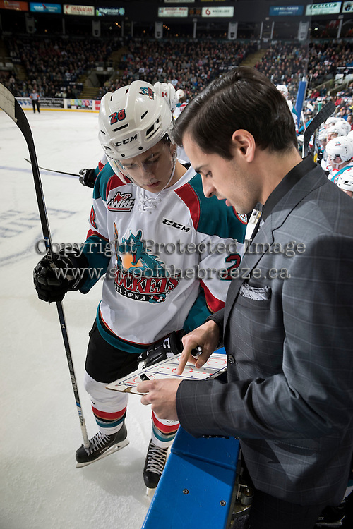 KELOWNA, CANADA - JANUARY 7: Leif Mattson #28 of the Kelowna Rockets goes over a play at the bench with assistant coach Travis Crickard against the Kamloops Blazers on January 7, 2017 at Prospera Place in Kelowna, British Columbia, Canada.  (Photo by Marissa Baecker/Shoot the Breeze)  *** Local Caption ***