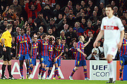 Barcelona's Lionel Messi celebrates with team mates after scoring a goal against VfB Stuttgart during their Champions League last 16, second leg soccer match. March 17, 2010. Camp Nou, Barcelona.