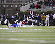 Ole Miss' Brandon Bolden (34) is chased by Louisiana Tech's Craig Johnson (14) in Oxford, Miss. on Saturday, November 12, 2011.