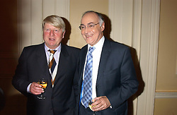 Left to right, STANLEY JOHNSON and MICHAEL HOWARD MP at a party to celebrate the publication o'Seventy Two Virgins' by Boris Johnson held at The Travellers Club, 106 Pall Mall, London on 14th September 2004.<br />