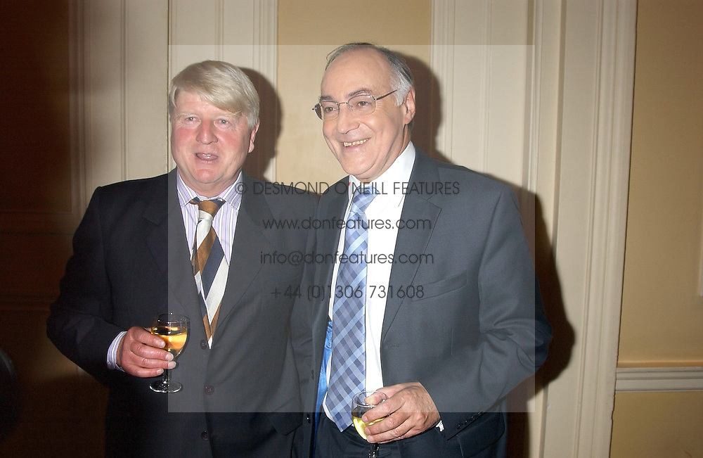 Left to right, STANLEY JOHNSON and MICHAEL HOWARD MP at a party to celebrate the publication o'Seventy Two Virgins' by Boris Johnson held at The Travellers Club, 106 Pall Mall, London on 14th September 2004.<br /><br />NON EXCLUSIVE - WORLD RIGHTS