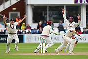 Wicket - Steve Davies of Somerset takes the catch to dismiss Dawid Malan of Middlesex off the bowling of Dom Bess of Somerset as Craig Overton of Somerset and Marcus Trescothick of Somerset celebrate during the Specsavers County Champ Div 1 match between Somerset County Cricket Club and Middlesex County Cricket Club at the Cooper Associates County Ground, Taunton, United Kingdom on 27 September 2017. Photo by Graham Hunt.
