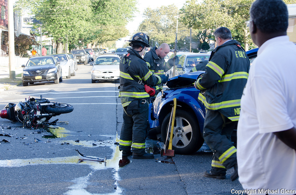 24 Aug 2013 Canarsie NYC USA//Motorcycle vs car at the intersection of Rockaway ave and ave L. One male from motorcycle with serious injuries