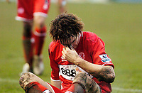 Photo: Leigh Quinnell.<br /> Nuneaton Borough v Middlesbrough. The FA Cup.<br /> 07/01/2006. Middlesbroughs Emanuel Pogatetz goes down with an injury.