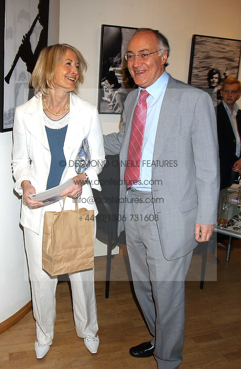 MICHAEL & SANDRA HOWARD at an exhibition of photographs by Robin Douglas-Home entitled 'The Sixties Set' held at The Air Gallery, 32 Dover Street, London W1 on 28th June 2005.<br />