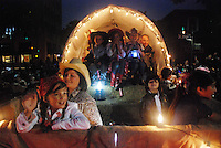 """Members of the float """"A Family Affair"""" wave to the crowds along Main Street during the Colmo del Rodeo procession."""