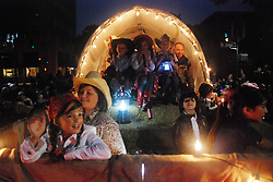 "Members of the float ""A Family Affair"" wave to the crowds along Main Street during the Colmo del Rodeo procession."