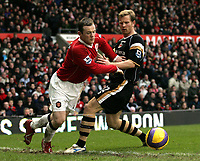 Photo: Paul Thomas.<br /> Manchester United v Charlton Athletic. The Barclays Premiership. 10/02/2007.<br /> <br /> Wayne Rooney (L) of Man Utd tries to get past Ben Thatcher.