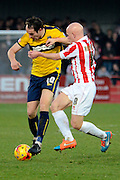 Danny Hylton shields the ball from Matt Richards during the Sky Bet League 2 match between Cheltenham Town and Oxford United at Whaddon Road, Cheltenham, England on 29 November 2014.