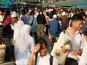 18 JUNE 2015 - PATTANI, PATTANI, THAILAND:   People walk through the Pattani Ramadan Bazaar, a sprawling street food market that is open during Ramadan. People come to the street food market late in the day to buy meals for the evening Iftar meal, which breaks the day long fast. Ramadan is the ninth month of the Islamic calendar, and is observed by Muslims worldwide as a month of fasting to commemorate the first revelation of the Quran to Muhammad according to Islamic belief. This annual observance is regarded as one of the Five Pillars of Islam. Islam is the second largest religion in Thailand. Pattani, along with Narathiwat and Yala provinces, all on the Malaysian border, have a Muslim majority.       PHOTO BY JACK KURTZ