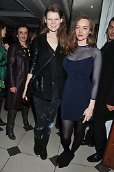 Left to right, models KELLY MITTENDORF and LOU HAYTER at a party hosted by TopShop to celebrate 10 years of NEWGEN and 10 years of supporting Brtish Fashion held at Le Baron, 29 Old Burlington Street, London W1 on 21st February 2012.