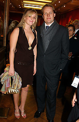 Left to right, ERIC & ERICA MATHIESEM at an aution of art inspired by footballer David Beckham in aid of The National Deaf Children's Society and held at Christie's, St.James's, London on 4th November 2004.<br /><br />NON EXCLUSIVE - WORLD RIGHTS