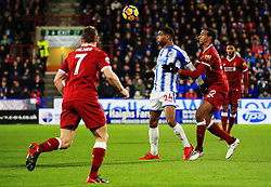 Steve Mounie of Huddersfield Town and Joel Matip of Liverpool - Mandatory by-line: Matt McNulty/JMP - 30/01/2018 - FOOTBALL - John Smith's Stadium - Huddersfield, England - Huddersfield Town v Liverpool - Premier League