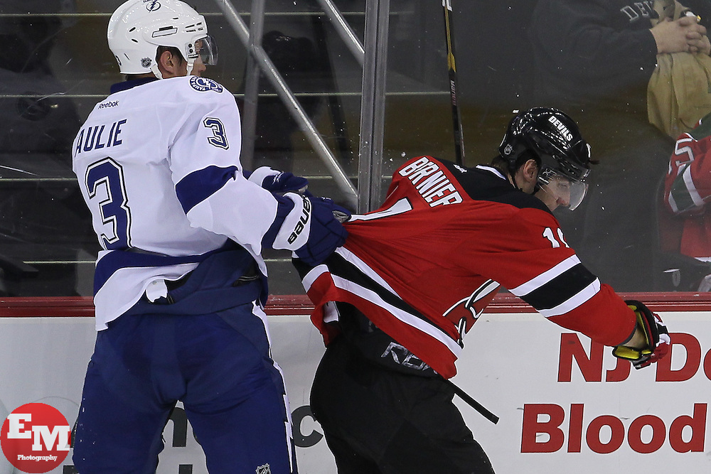 Mar 29; Newark, NJ, USA; Tampa Bay Lightning defenseman Keith Aulie (3) grabs the jersey of New Jersey Devils right wing Steve Bernier (18) during the third period at the Prudential Center. The Devils defeated the Lightning 6-4.