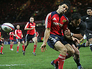 Doug Howlett of Munster is hit hard in a tackle from All Black Anthony Tuitavake Munster vs New Zealand rugby match, Thomond Park Stadium, Limerick, Ireland. Tuesday, 18th November 2008. Photo: Tim Hales/PHOTOSPORT