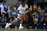 Nov 15, 2019; Los Angeles, CA, USA; UCLA Bruins guard Prince Ali (23) is defended by UNLV Rebels guard Elijah Mitrou-Long (55)  in the first half at Pauley Pavilion. UCLA defeated UNLV 71-54.